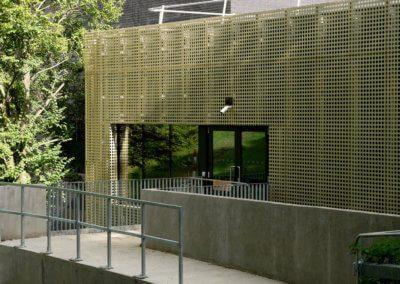AE building - Gold metal cladding around doors & window.
