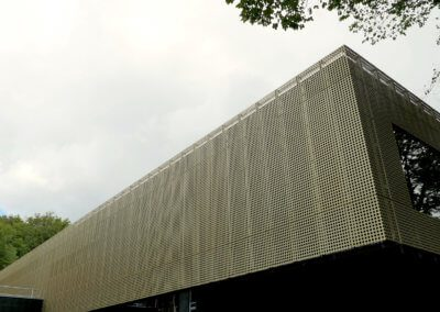 AE Building - Gold anodised metal cladding