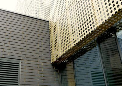 AE building - Formed cladding wall abuttment.